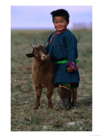 Boy-Wearing-Traditional-Dell-Standing-Next-to-Baby-Goat-Mongolia-Photographic-Print-C12454834